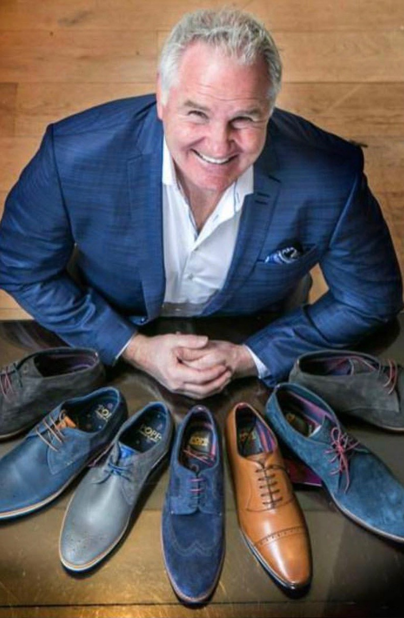 Brent Pope with a sample of his shoe collection form his luxury brand, Instagram, @popecreatedbybrent @popeapparel #brentpope