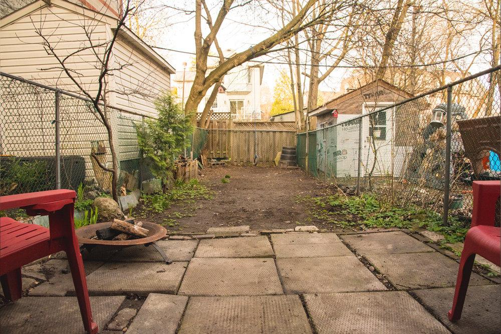 lil-yellow-house-backyard-back.jpg