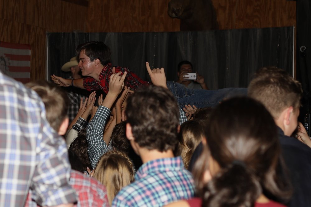 "Sophomore Anson Eggerss surfs the crowd after his performance of ""That's What I Like."""
