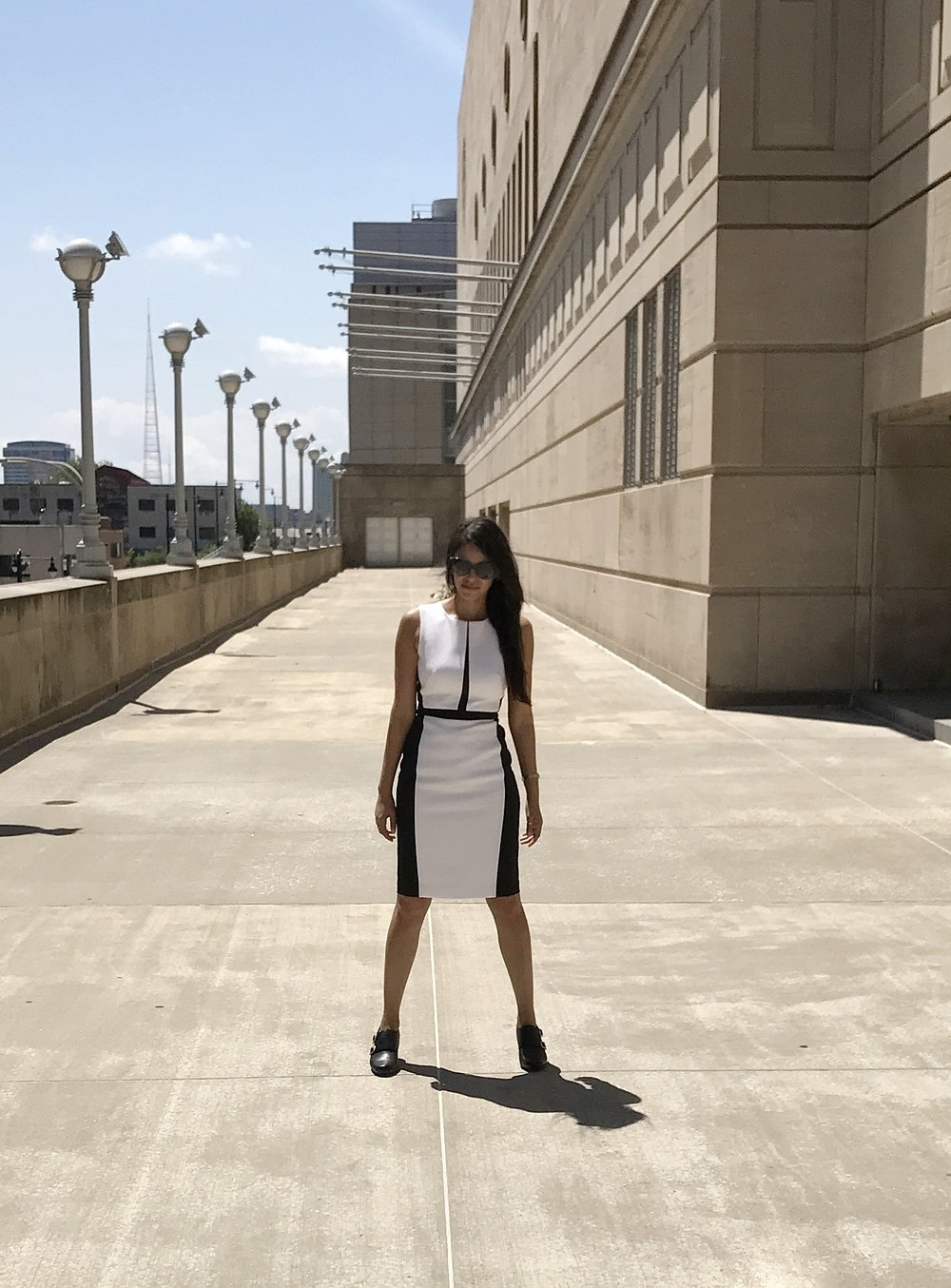 - The colorblock white and black print really brings out the feminine cut.