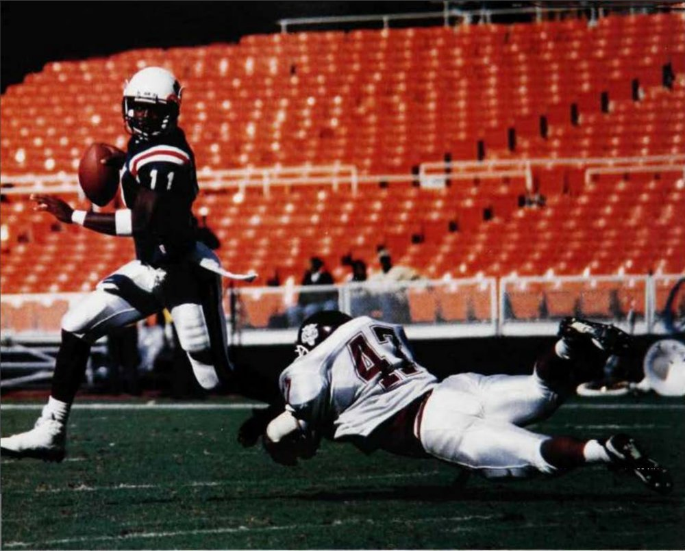 Quarterback Larry Connor evading a Morehouse defender.