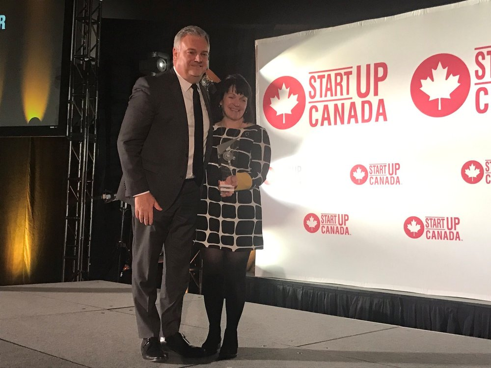 Kari Gordon, Executive Director at Startup Calgary receiving the Startup Canada Community Leader of the Year Award for Western Canada, sponsored by Rogers.  Photo: Startup Canada