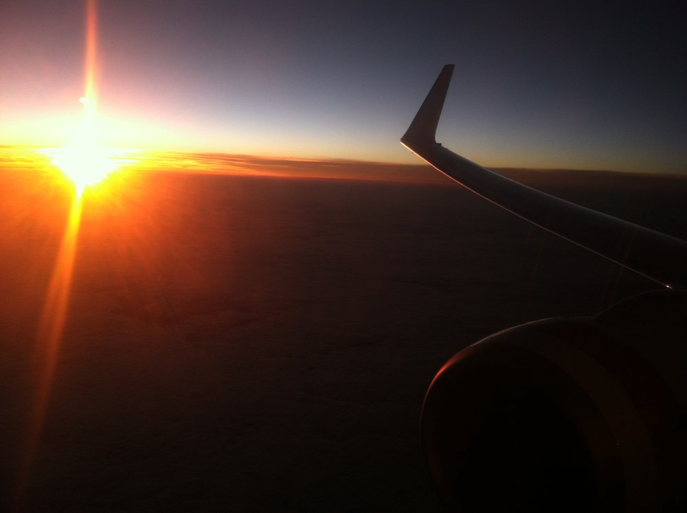 Flying to New Zealand at sunset