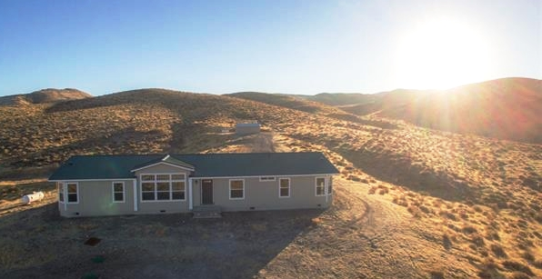Off the grid! Get away from it all while only being minutes from town! Incredible views all around on this 39.5 acre lot. This home is MASSIVE, over 2100 square feet and has a metal roof to protect against the elements. HUGE SHOP on site for the RV storage or the handyman in the family! 3 of the bedrooms feature en suite bathrooms! The master features dual sinks, a separate shower and garden tub and incredible views for miles.  Price: $274,900