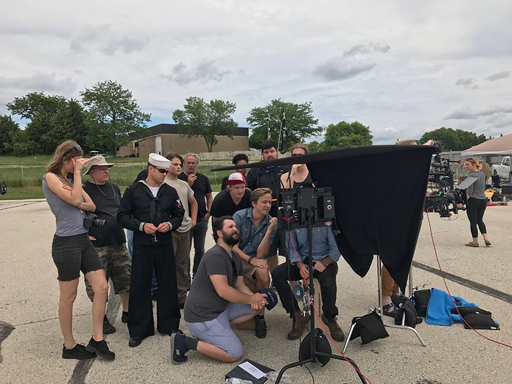 Cast & crew looking at the monitor