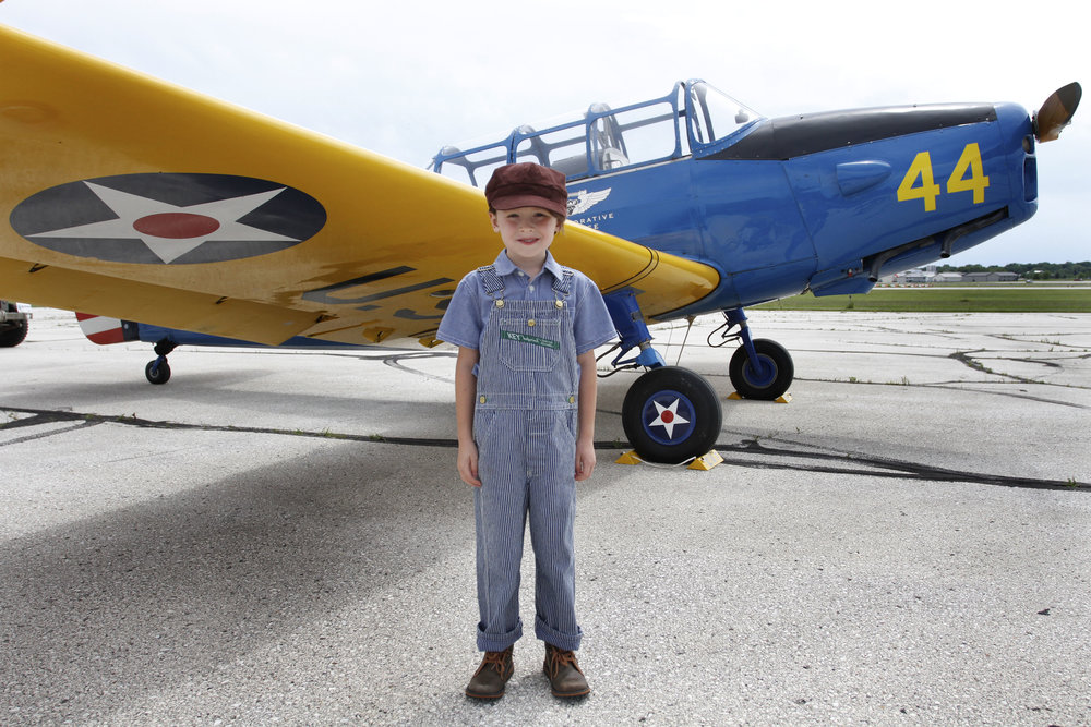 Young Lester in front of a plane.