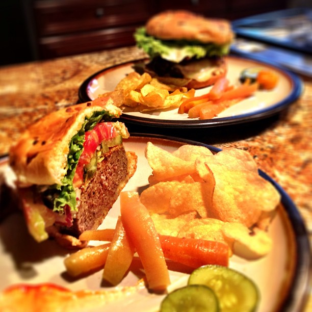 Chargrilled Grass Fed Beef Burger with pickled carrots & chips