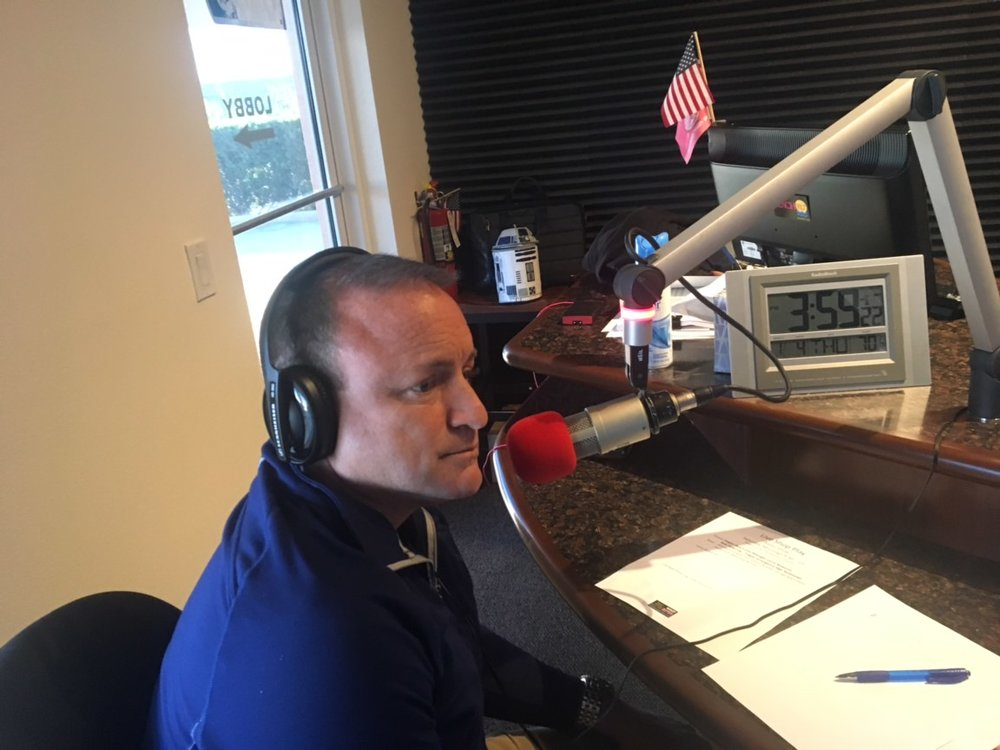 "Joe mullins in the wnzf studios in flagler county, fla., during the debut episode of ""live, shop, play in flagler county."""