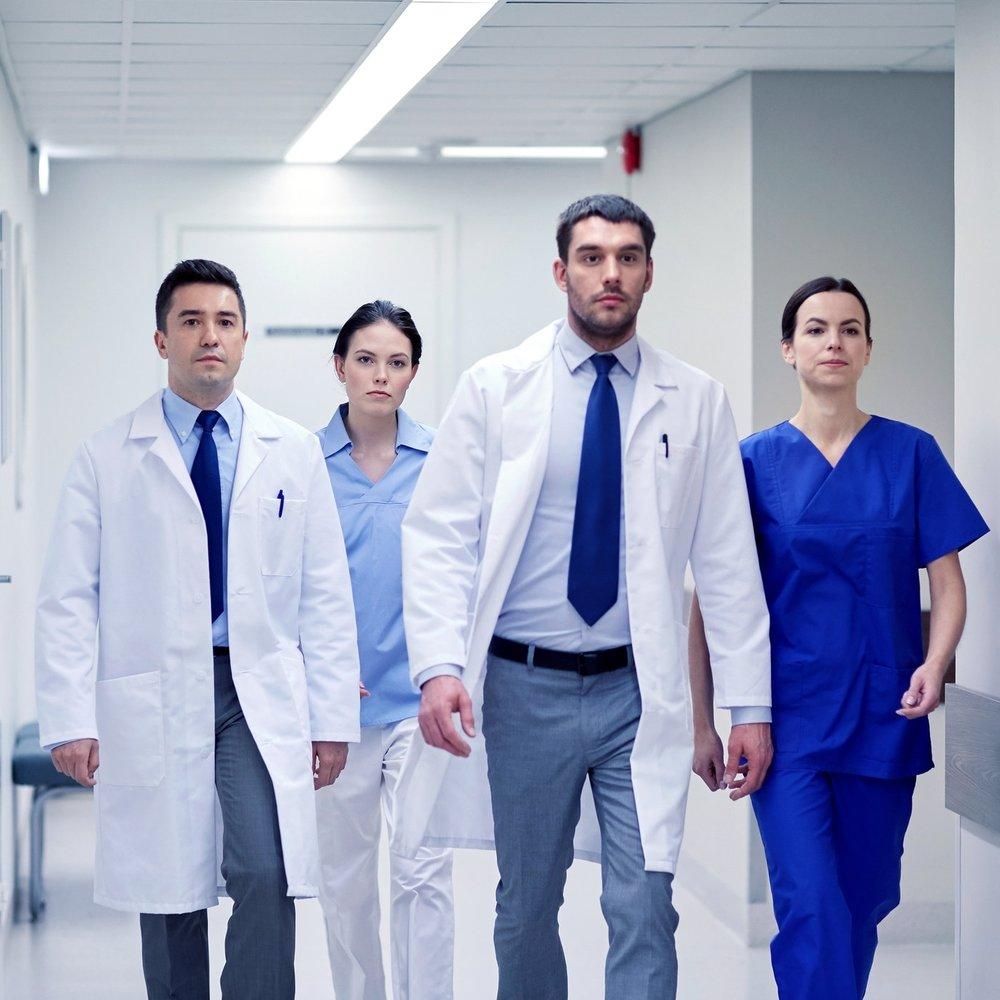 groupofmedicswalkingalonghospital.jpg