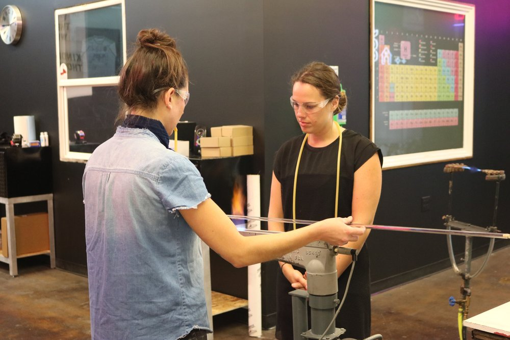 Kacie working with a student on bending techniques. Image  ©  2018 WNSA.