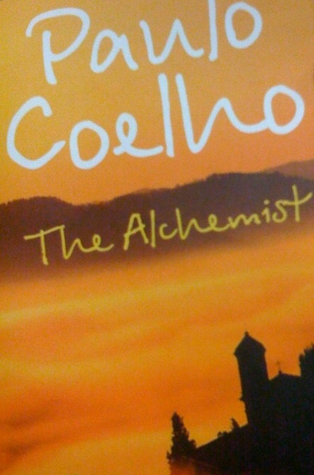 """"""" The Alchemist by Paulo Coelho """" by  SoniaT 360 , used under  CC BY 2.0  / cropped from original"""