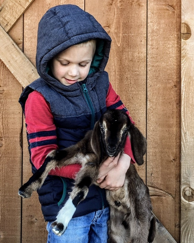Dr. Holloway's son takes after his mom in her love of small ruminants.