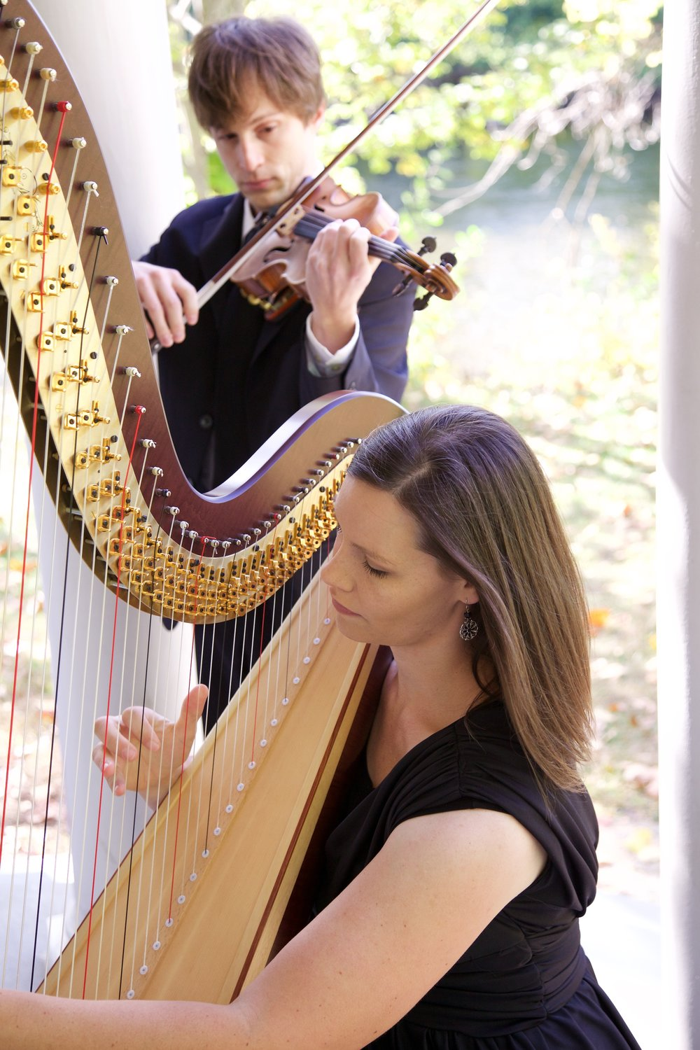 Our violin and harp duet performing at a wedding ceremony