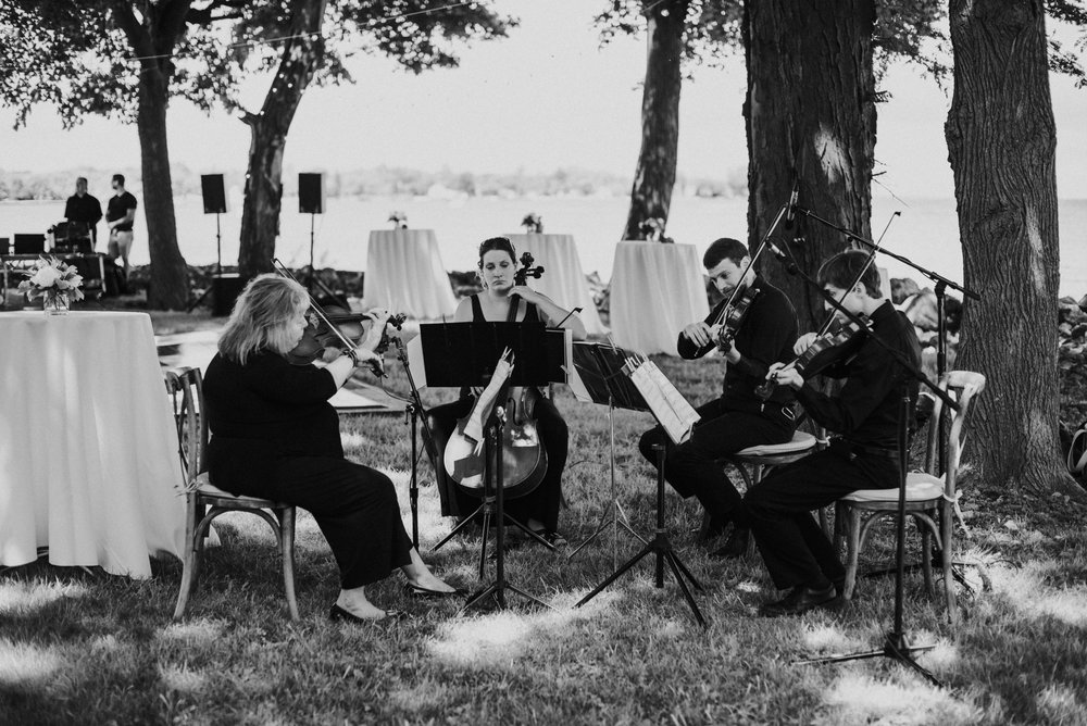 White Pines Entertainment string quartet performing during the ceremony. Image by  Aster + Olive Photography