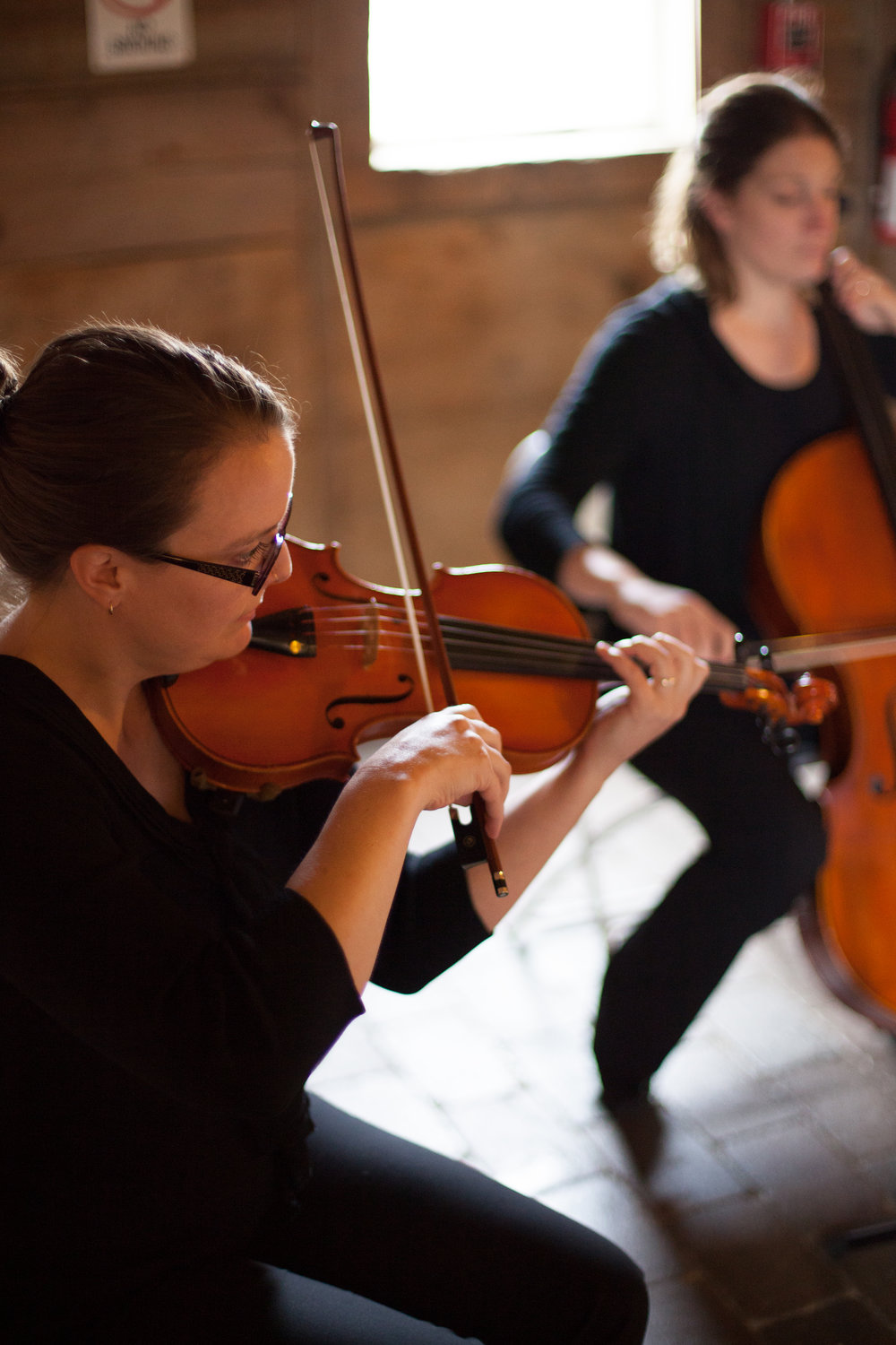 White Pines Entertainment string duet performance captured by Jen at  Bullinger Photography