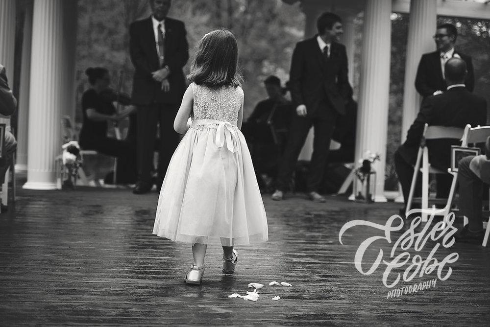 flower girl walks up the aisle