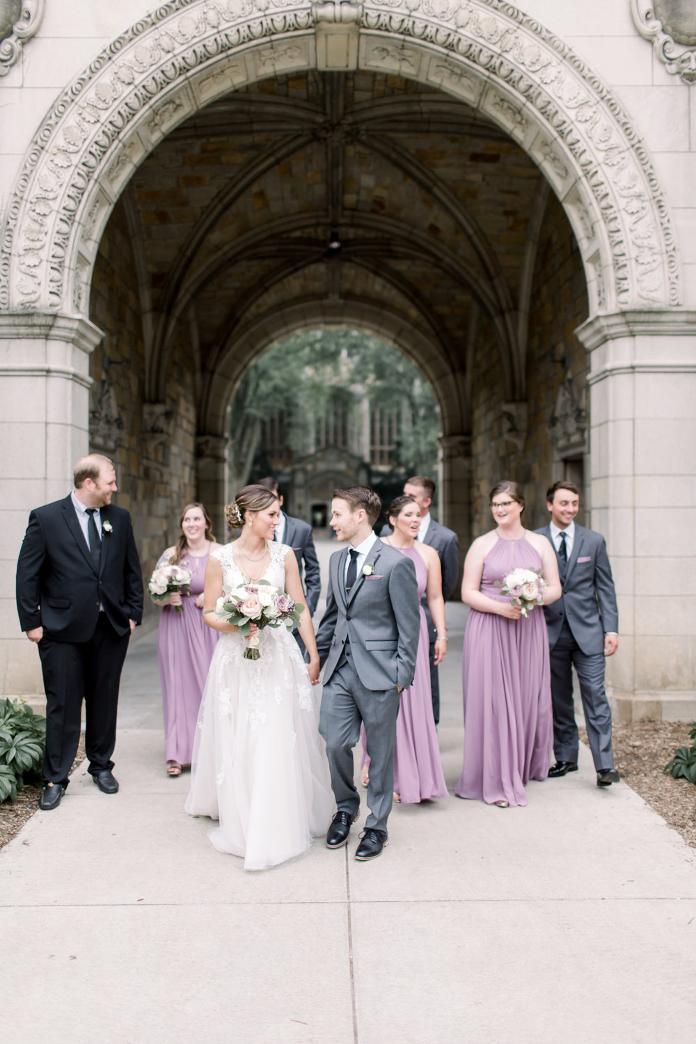 The bride and groom with their wedding party on the University of Michigan campus. Captured by Tiffany Kelly of  TRK Photography