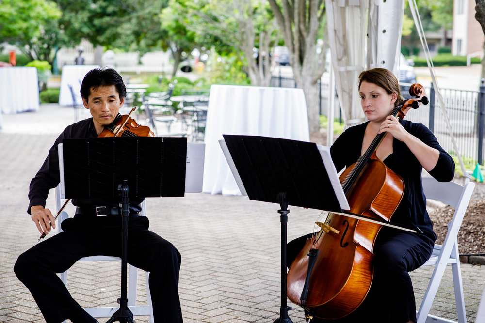 White Pines Entertainment String Duet plays prelude music as captured by Matt Mollan of  Mollan Photography