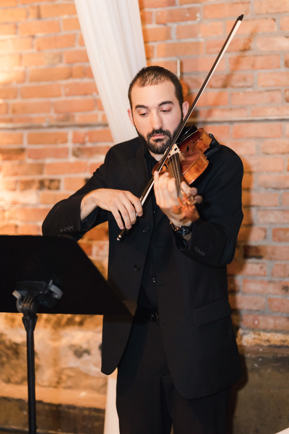 Solo violinist Daniel Winnick performs prelude music for wedding ceremony. Captured by  Stephanie Kaslly Photography.