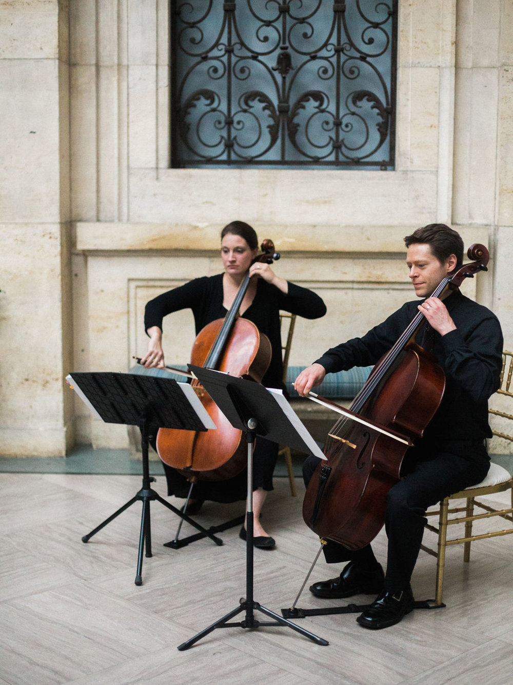 Cello Duet performing prelude music at the Detroit Institute of Arts as captured by  K.R. Moreno