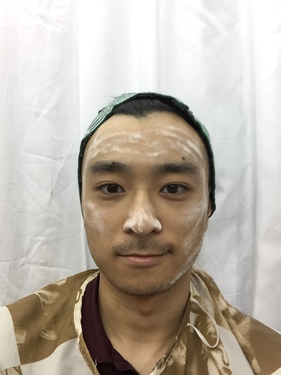 Before threading my face the practitioner applied some white powder on my face