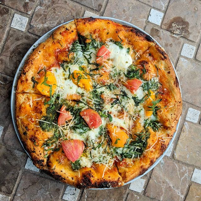 #heirloomtomatoes and #pesto #margherita #pizza. Yum!