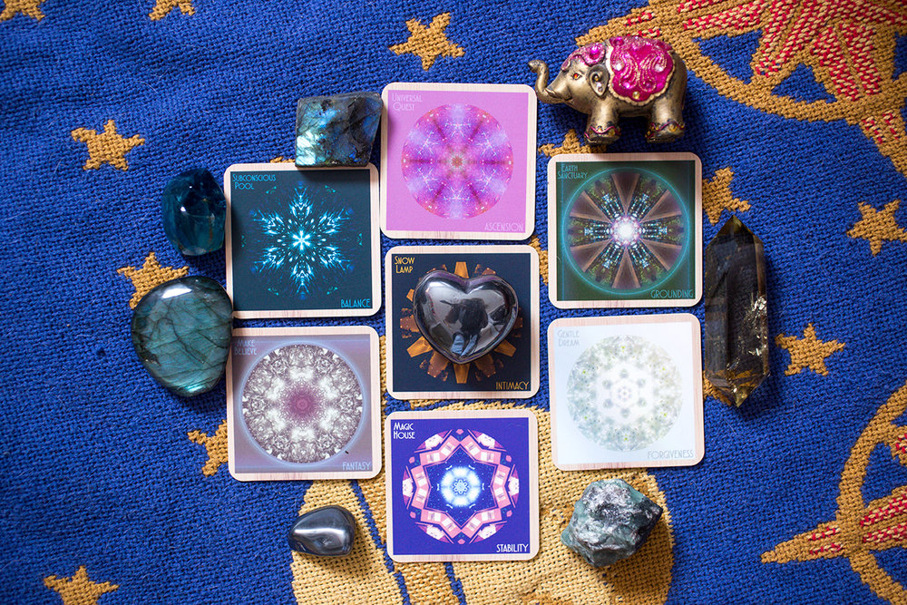 Indigo Corners™ Oracle New Moon in Cancer ☆7 Card Mandala Spread: Card 1 (Present): Subconscious Pool/BALANCE, Card 2 (Future): Universal Quest/ASCENSION, Card 3 (What to focus on) Earth Sanctuary/GROUNDING, Card 4 (What to move through and release) Gentle Dream/FORGIVENESS, Card 5 (What is hidden) Magic House/STABILITY, Card 6 (Additional info) Make Believe/FANTASY, Card 7 (Theme) Snow Lamp/INTIMACY. Crystals: Elephant for passing by obstacles, hematite for ultimate grounding and self-reliance, blue fluorite for expression of uniqueness, emerald for strength of knowing one's own heart and labradorite for magic, magic magic magic!