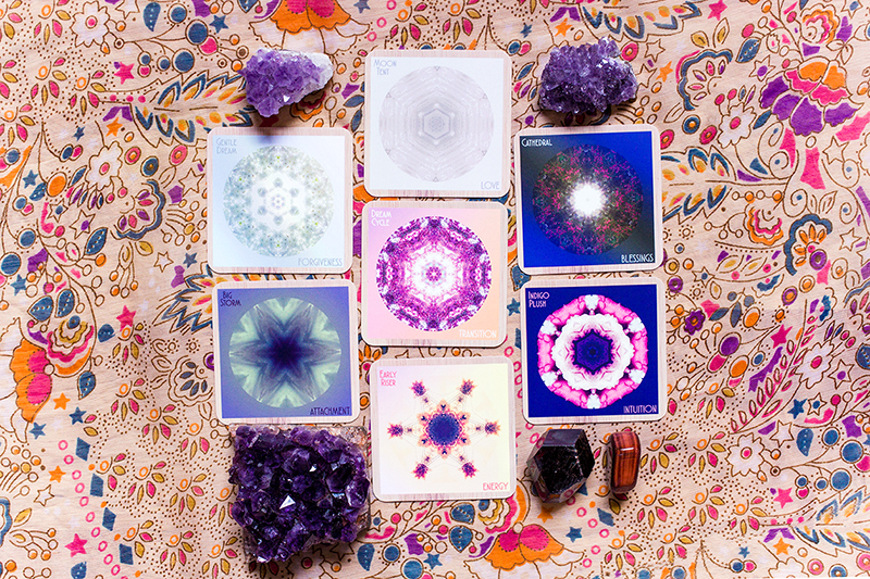 Card 1 (present): Gentle Dream/FORGIVENESS, Card 2 (near future): Moon Tent/LOVE, Card 3 (what to focus on): Cathedral/BLESSINGS, Card 4 (move through and release): Indigo Plush/INTUITION, Card 5 (what is hidden): Early Riser/ENERGY, Card 6 (additional info): Big Storm/ATTACHMENT, Card 7 (issue or theme): Dream Cycle/TRANSITION. Crystals: amethyst for knowing the self, garnet for deep self-love, red tigers eye for passion for life.