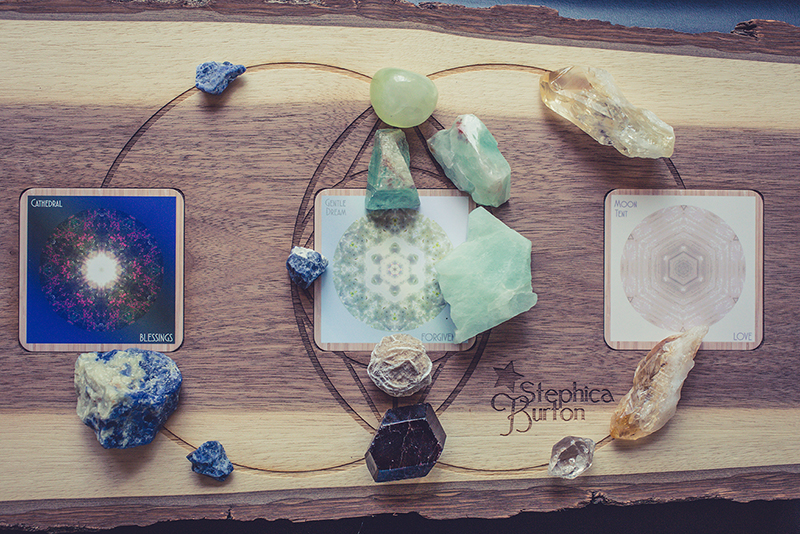 Cards: Cathedral/BLESSINGS, Gentle Dream/FORGIVENESS, Moon Tent/LOVE Crystals: sodalite for recognizing and receiving opportunity, green calcite, prehnite, aquamarine, desert rose for a kind and open heart and connection to nature, garnet for deep love of life, citrine for joyful expression and experience.