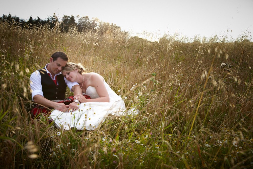 Bride & Groom Sitting in a Field - Romantic Weddings at Huntstile Farm