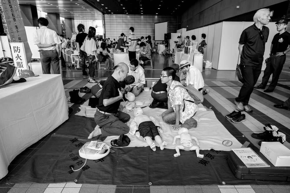 Fujifilm X-Pro1 - 14mm f/2.8 - 1/60 - f/5.6 - iso400 Lots of people trying to push dolls into the pavement or something.