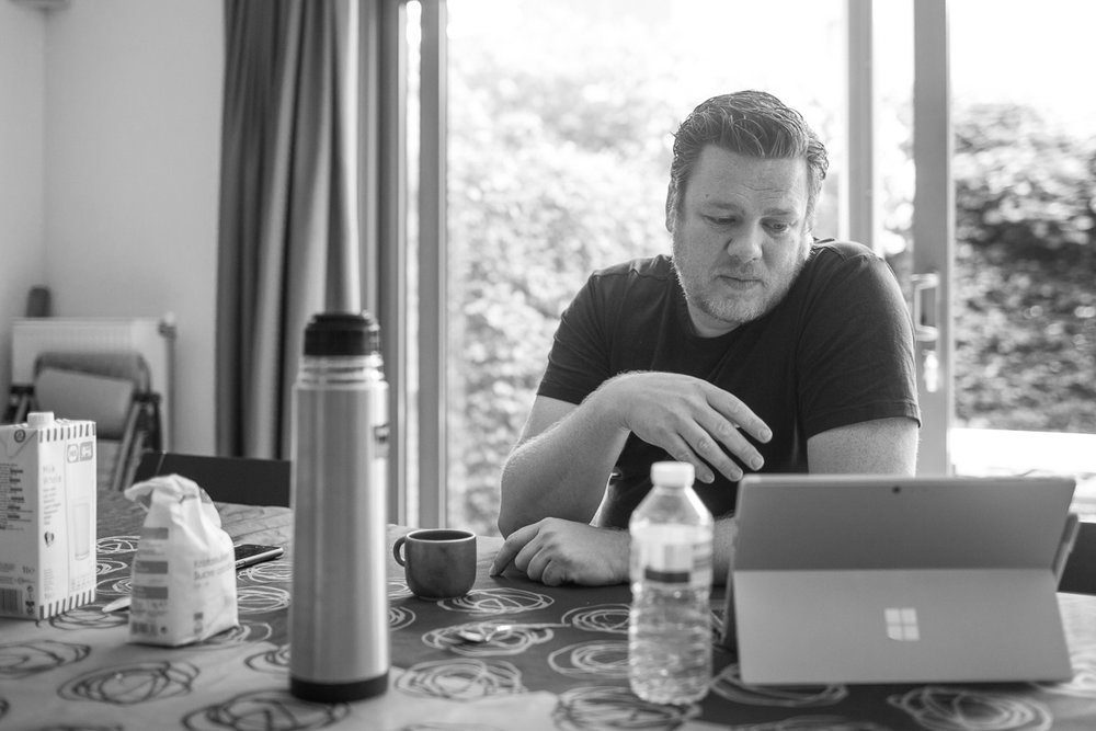 During a pre-workshop morning meeting at my living room table. The computer part is in the screen housing so there's less chance that I will kill another computer by spilling coffee on the keyboard (don't ask).