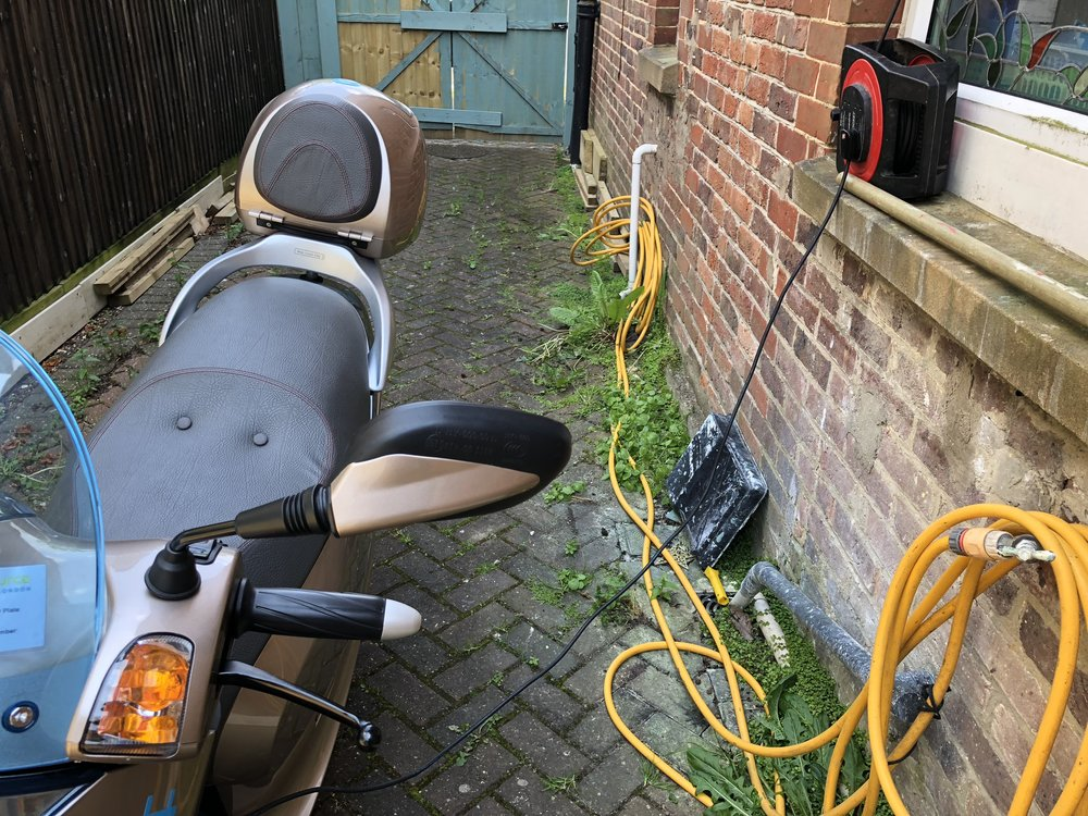 My house has a side alley leading to my garage, so I can run a lead to any bike or scooter. This EcCity Scooter, is slim and can fit down most passageways to aid charging locations. The battery is fixed and the  3 pin plug connects directly to it, allowing easy charging from a normal outlet.