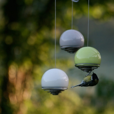 belle-birdfeeders-by-green-and-blue-with-birds-feeding-1000x1000.jpg