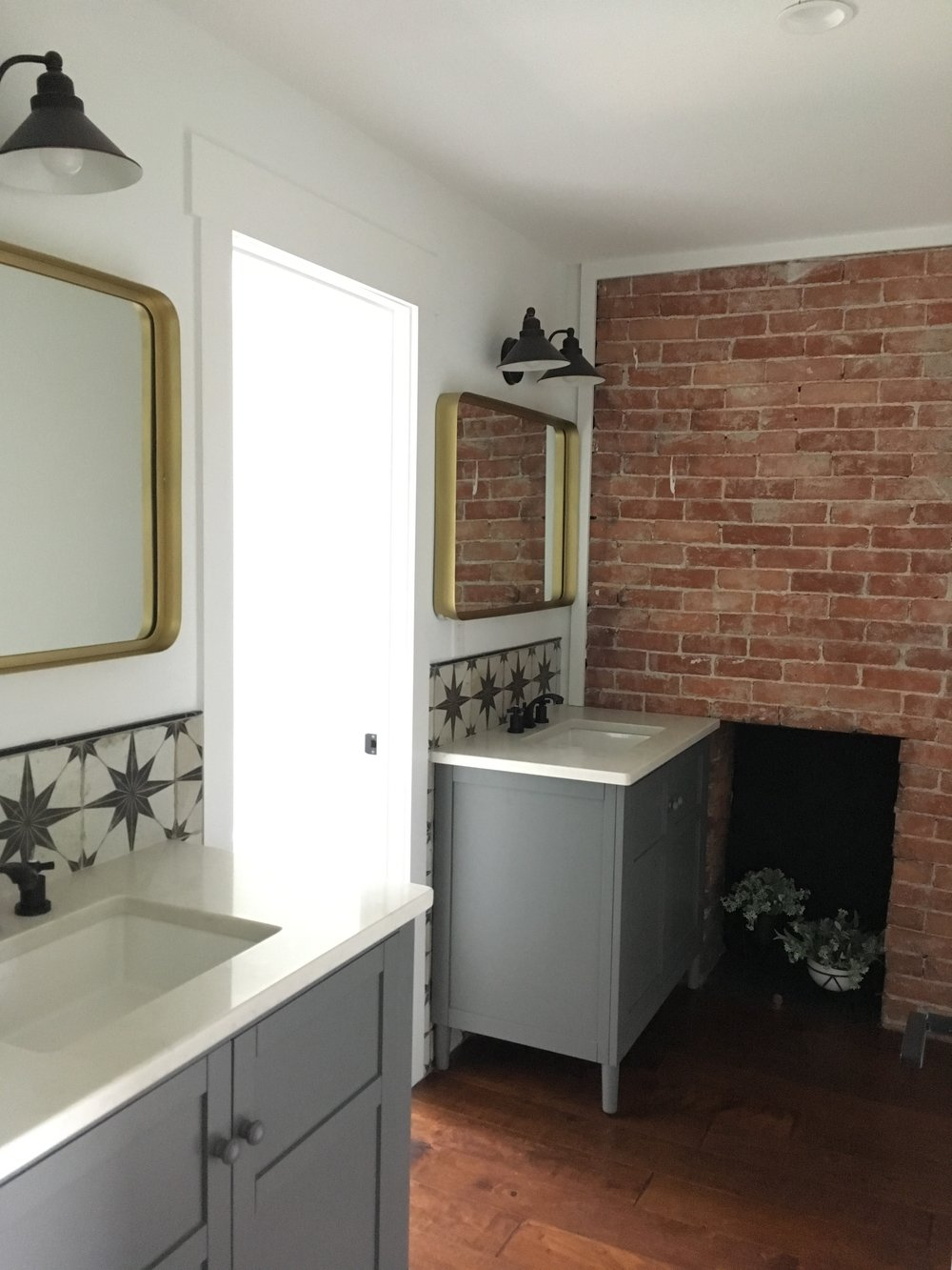 After: double vanities with a separate water closet and shower room increase privacy and allow everyone to get ready at the same time.