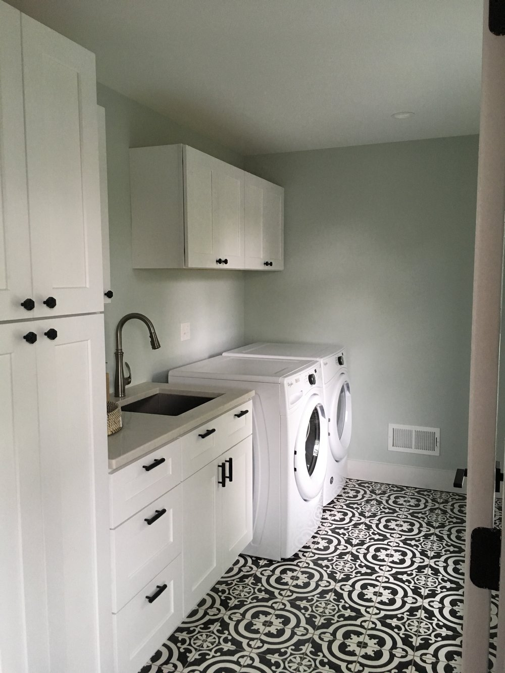After: the laundry room - plenty of storage with a fun, graphic floor tile.