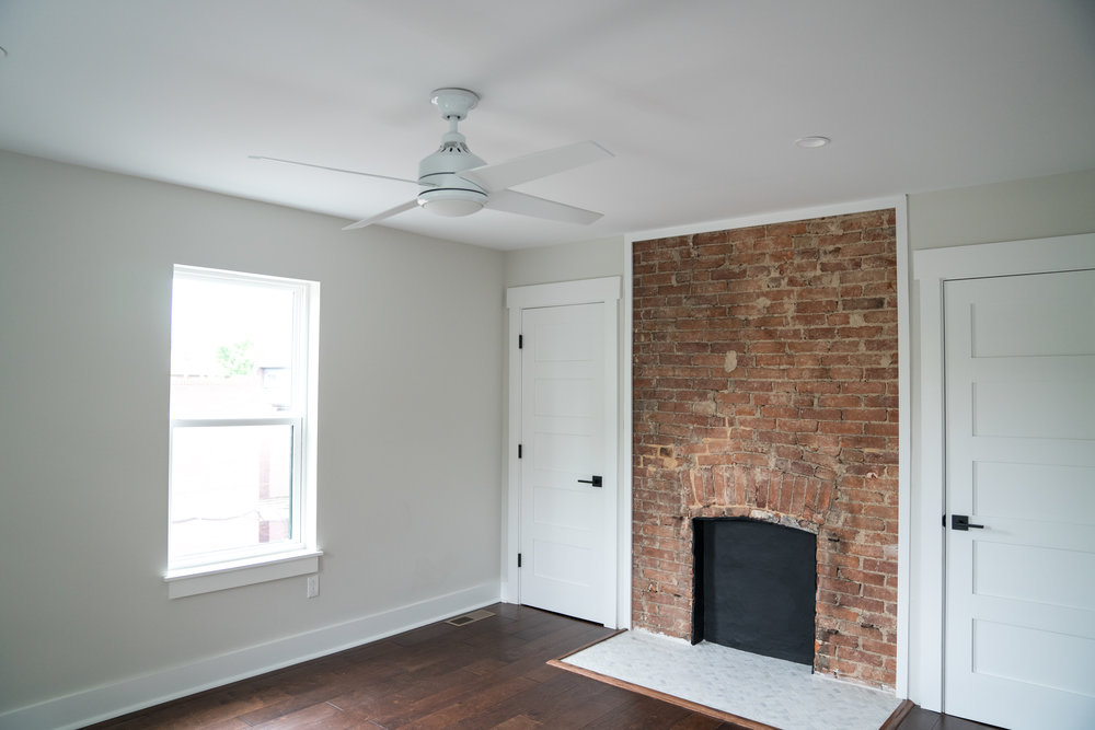 After: in the bedroom, closets were added on either side of the fireplace for storage that appears to be original.