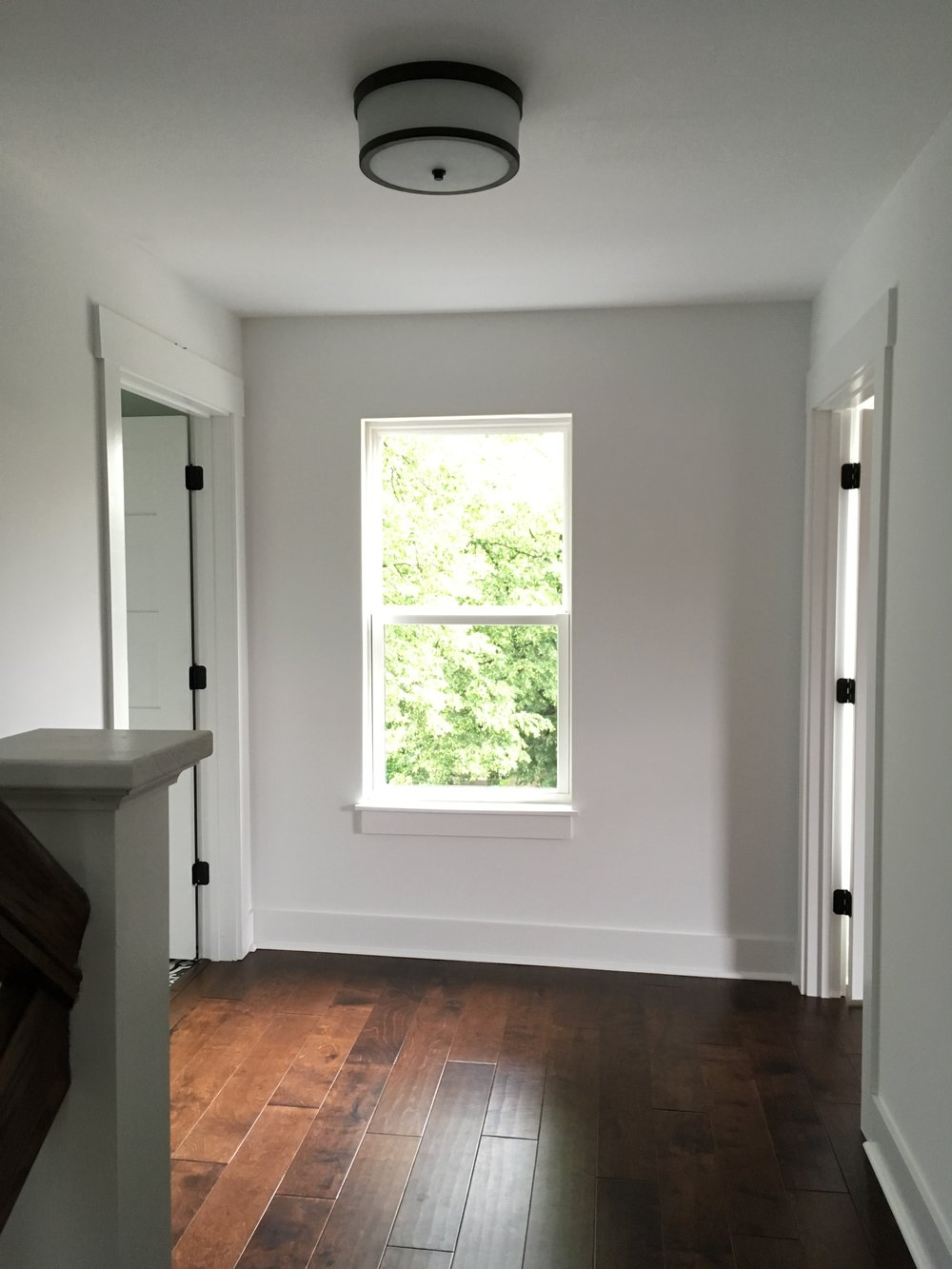 After: the window is no longer centered in the hallway because the wall on the right was shifted to accommodate the wider stairs.