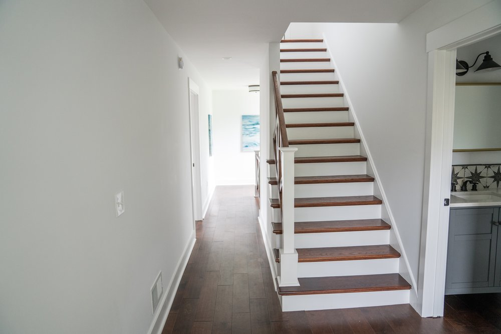 After: the awkward turn in the stairs was eliminated when the stairs were rebuilt and the hallway was widened.