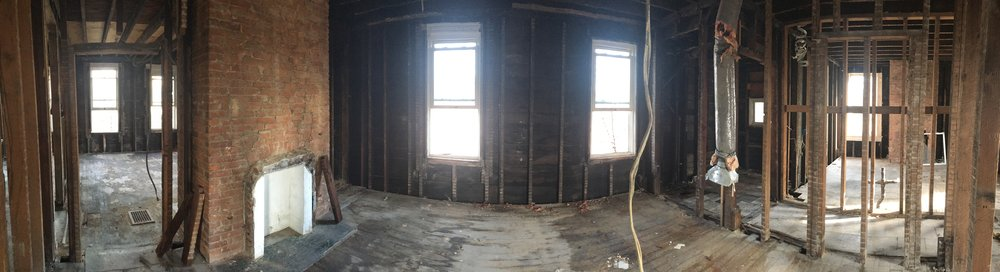 Before: a wide-angle show shows the master bedroom in the center.