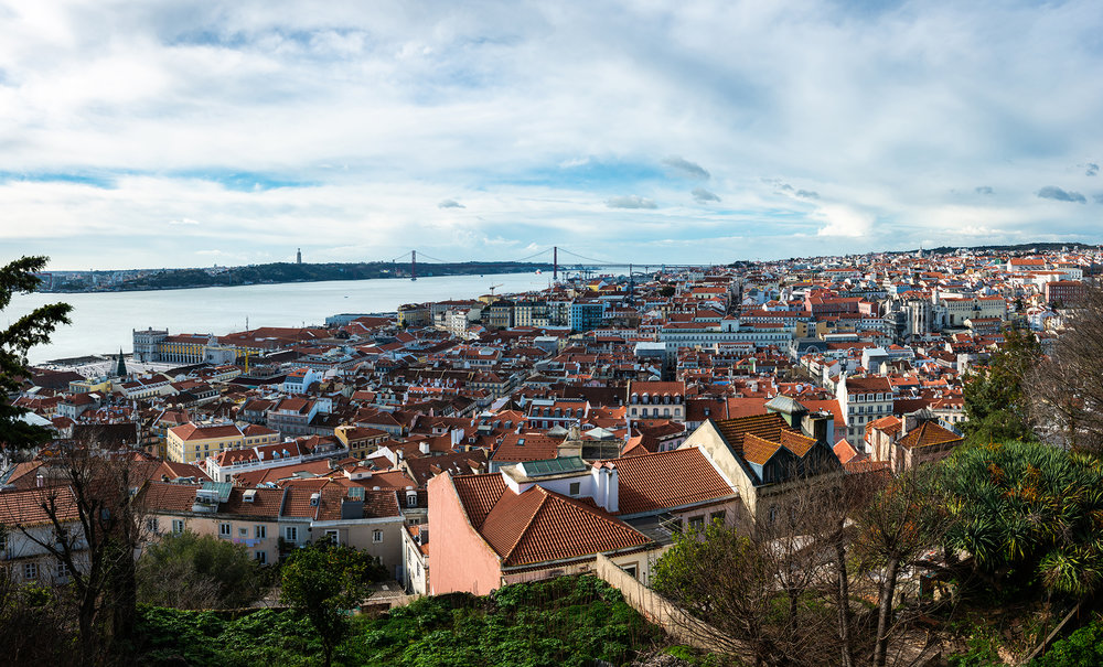 Skyline of Lisbon, with Almada and the 25 de Abril bridge over the Tagus river in the background