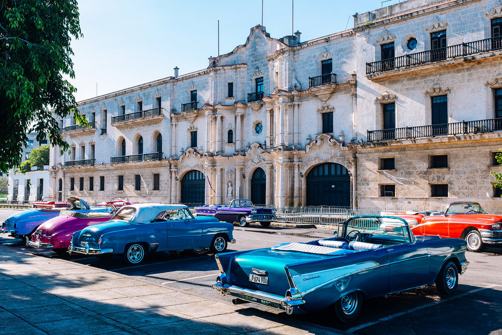 American vintage convertible cars parked by the Luz Caballero park