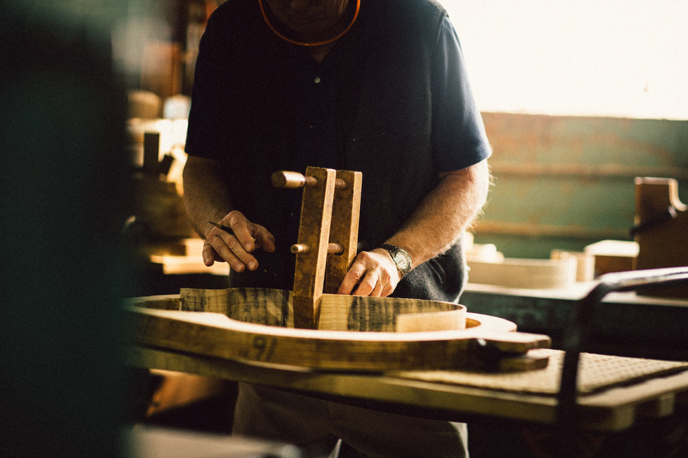 Co-founder Jim Deurloo works on a guitar.