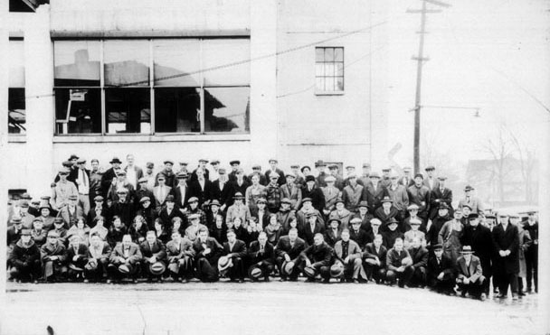 Staff in Front of Building - ca. 1920