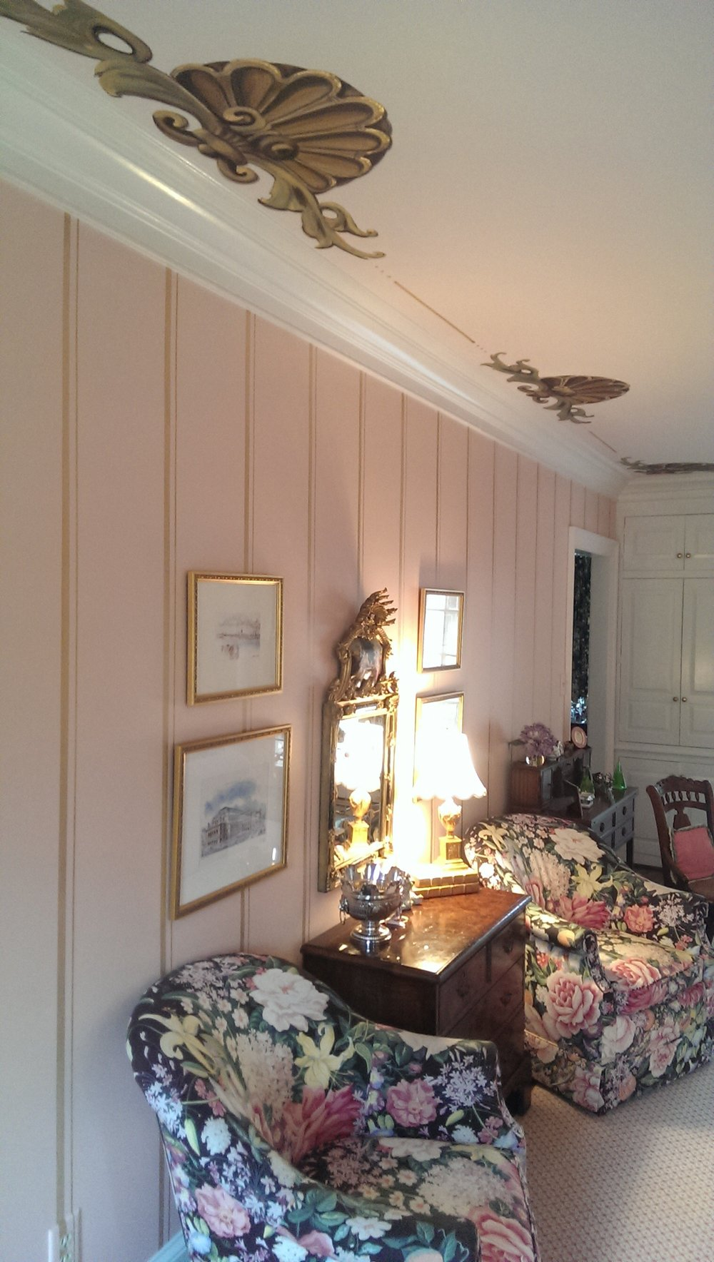 Ornate hand painted ceiling design and gold striped walls