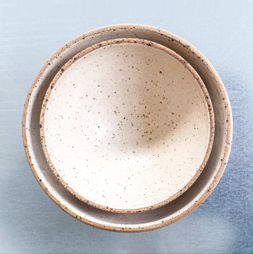 BOWLS (CREAM)   Individually hand thrown using texturised stoneware. Finished with cream or blue glossglaze on the inside.  Waterproof & dishwasher-proof  Approx dimensions  Ø: 15 - 25 cm  H: 10 - 15 cm