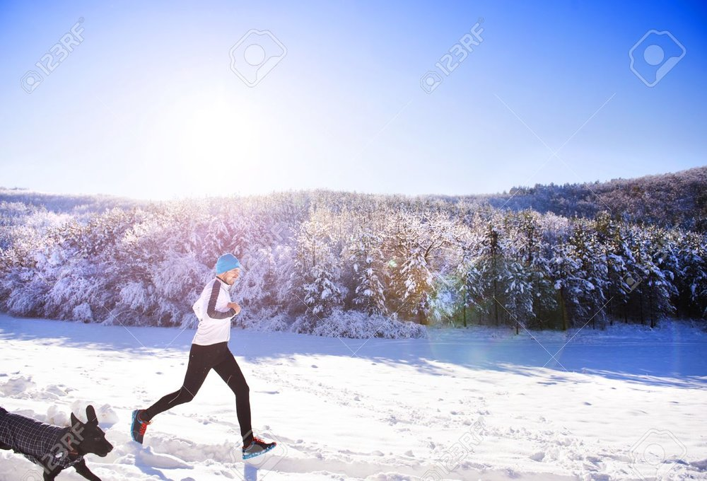 36323790-Young-sportsman-jogging-with-dog-outside-in-sunny-winter-park-Stock-Photo.jpg