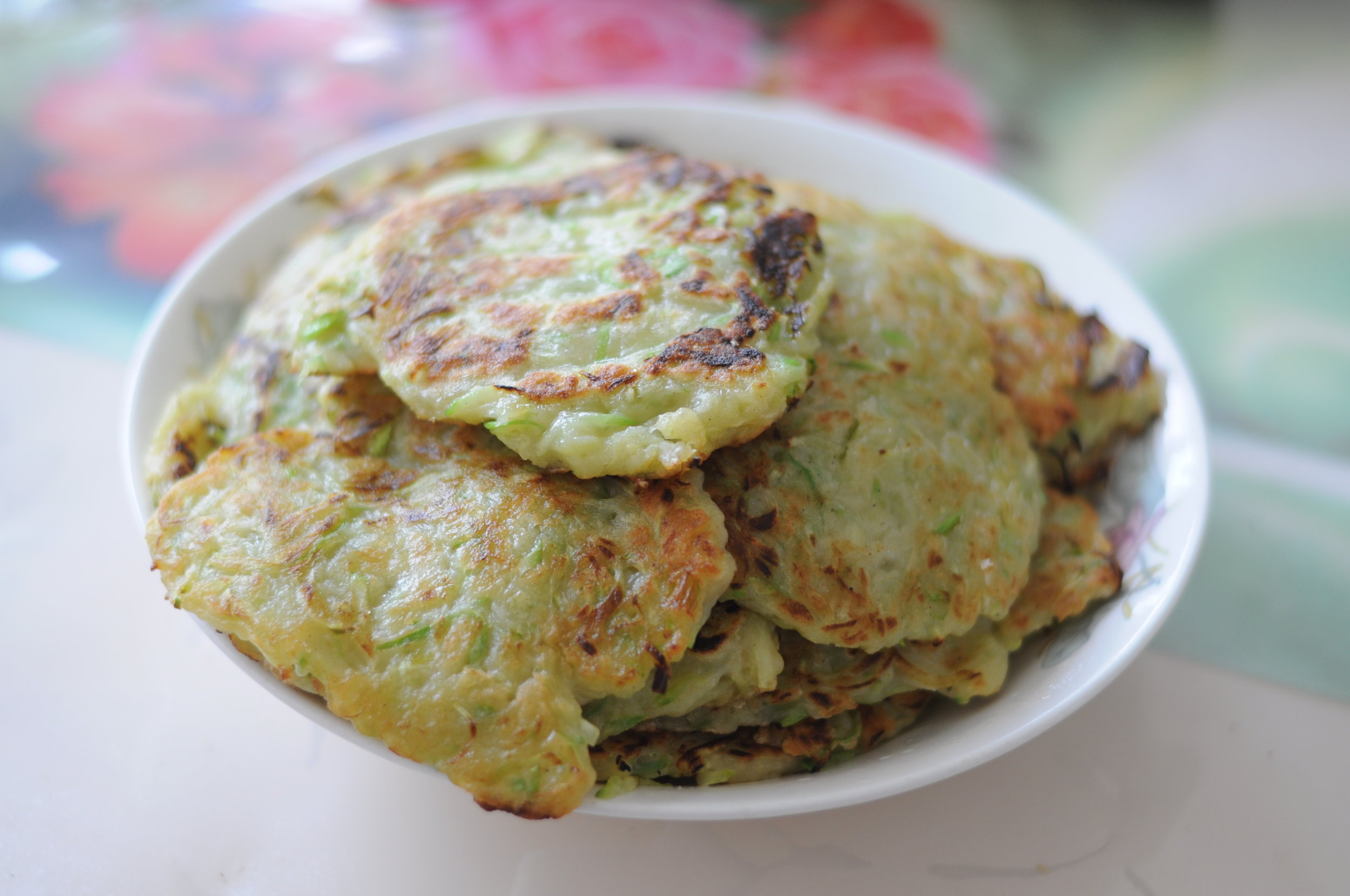 Pancakes made of grated squash, flour, and eggs.
