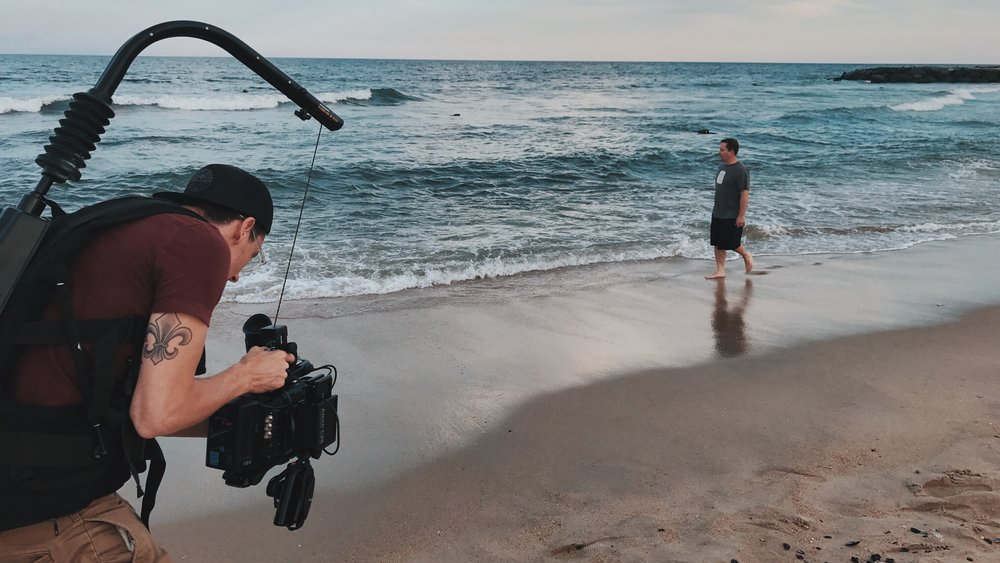 new-jersey-video-production-hologram-visuals-new-york-commercials-ad-branded-content-withum-smith-brown-bts-beach-ursa-mini-easyrig.jpg