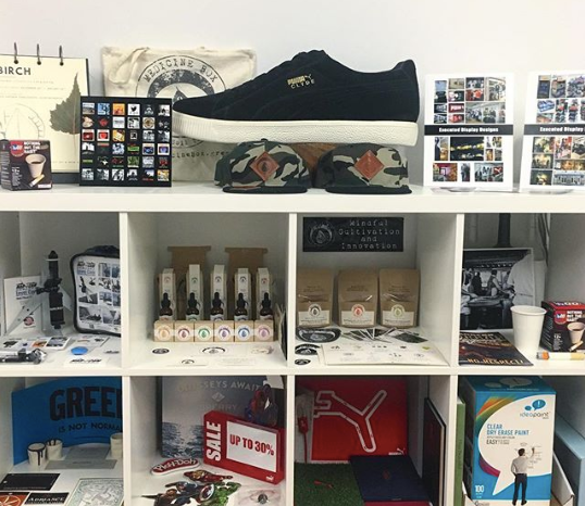 A studio display of many of Designer151's projects, including marketing and branding materials for Hasbro, Puma,  Alex  And Ani, MarCam, Sperry, and many more!